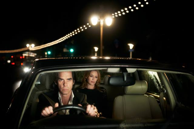 Nick Cave drives Kylie Minogue